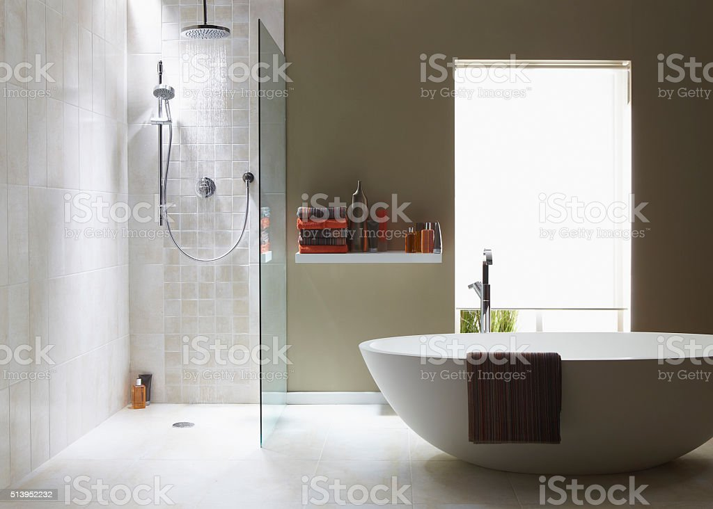Interior of bathroom in cool green with a running shower stock photo