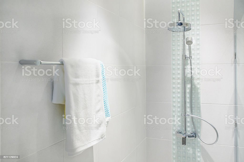 Interior of bathroom with modern shower head and white towel. stock photo