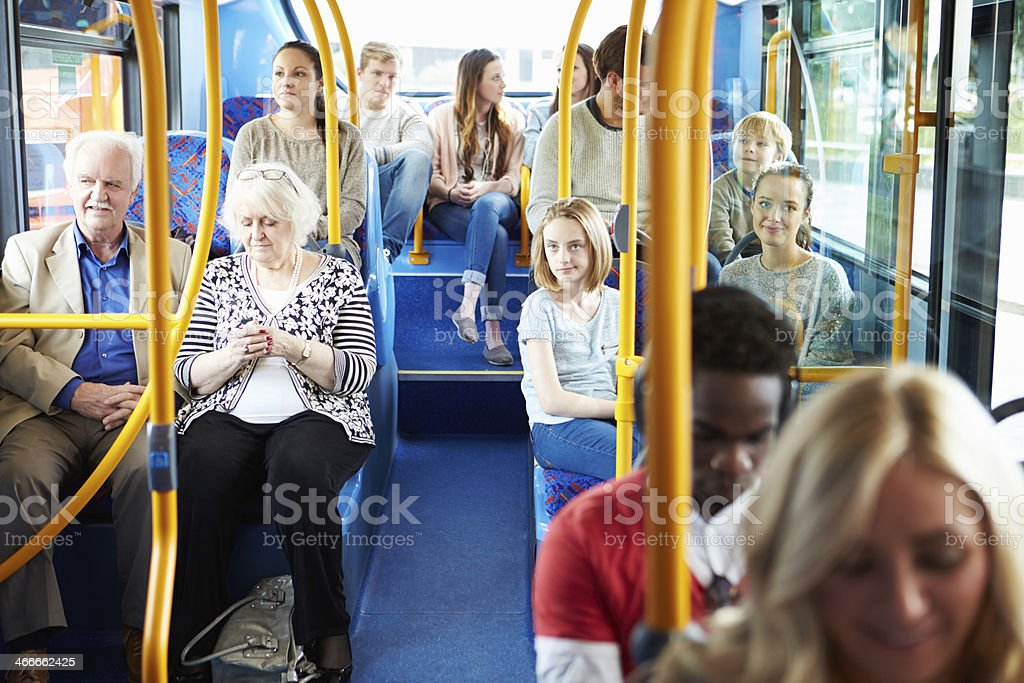 Interior Of Bus With Passengers stock photo