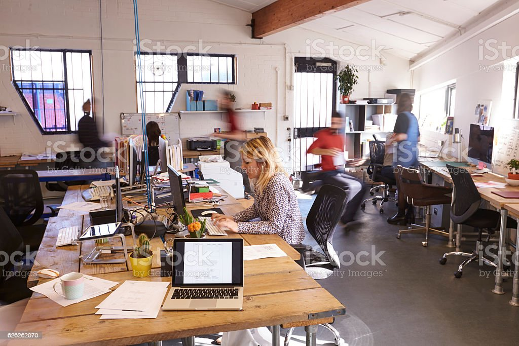 wide angle view busy design office. interior of busy design office with staff stock photo wide angle view