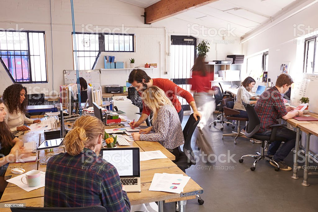 Interior Of Busy Design Office With Staff stock photo