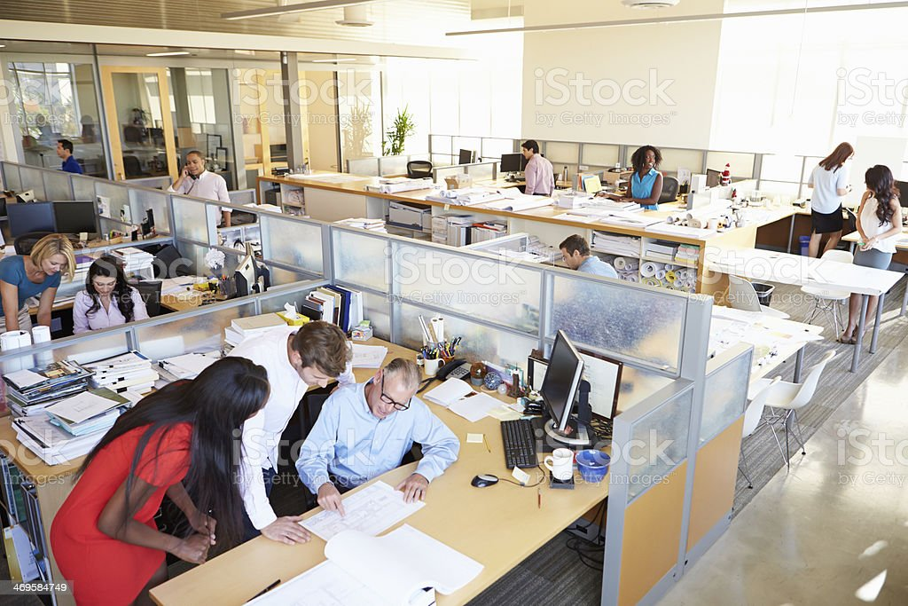 Interior Of Busy Modern Open Plan Office royalty-free stock photo