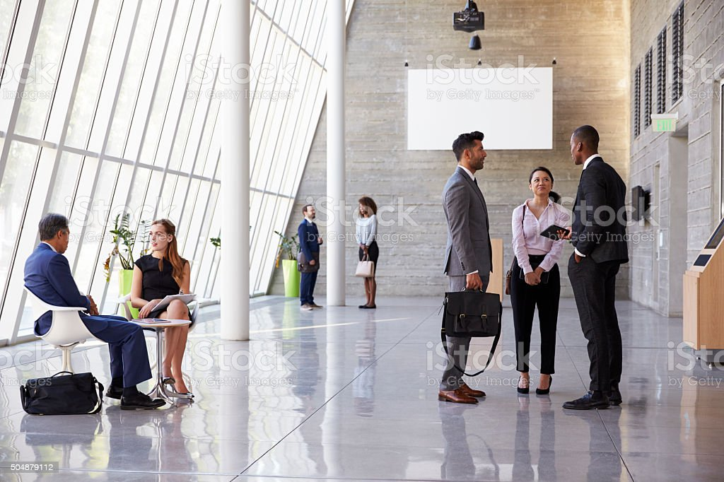 Interior Of Busy Office Foyer Area With Businesspeople stock photo