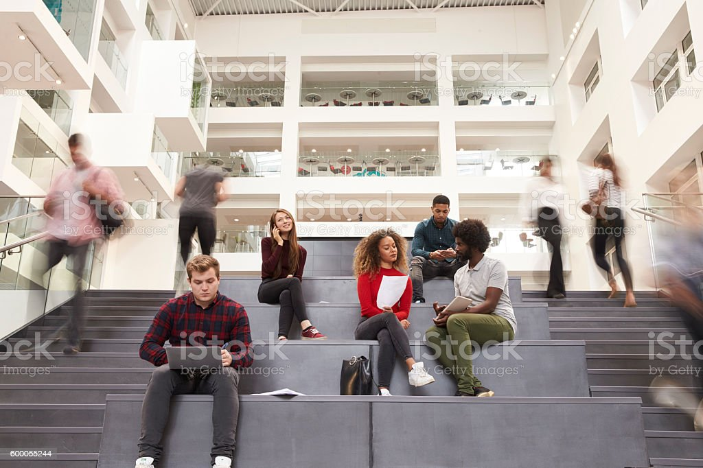 Interior Of Busy University Campus Building With Students stock photo
