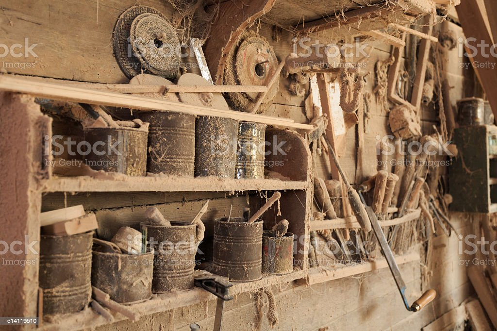 Interior of carpentry with tools and wood workpieces stock photo