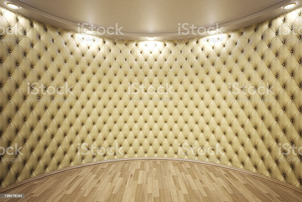 Interior of circular room with studded leather wall covering royalty-free stock photo