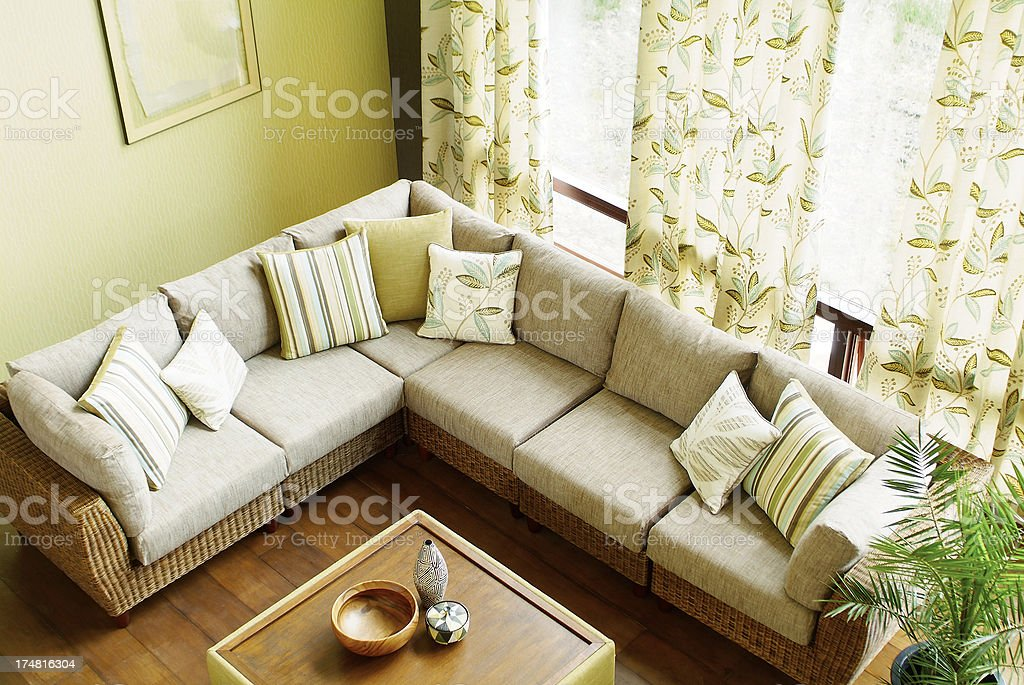 Interior of corner three seater sofa in living room royalty-free stock photo