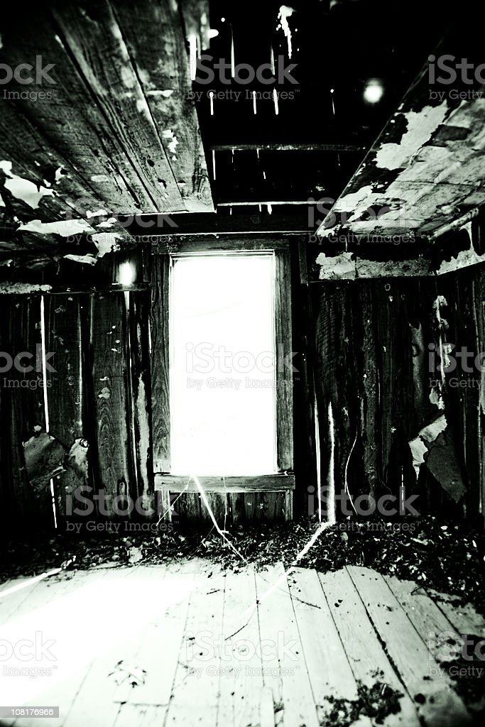 Interior of Creepy Abandoned House with Window royalty-free stock photo
