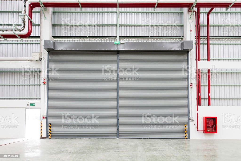 Interior of factory with shutter door stock photo