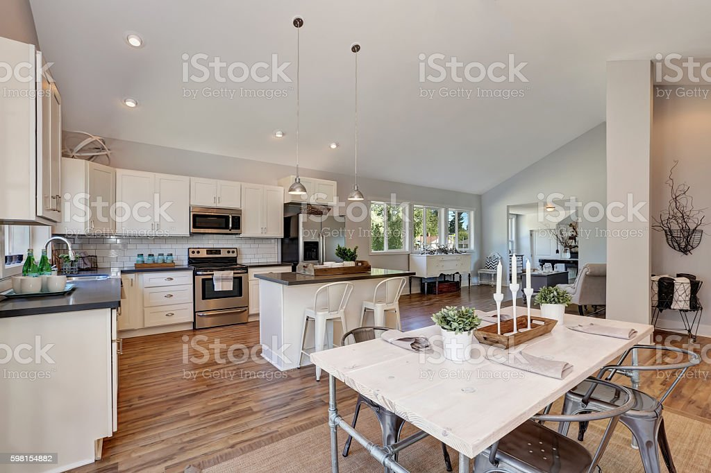 Interior of kitchen and dining room with high vaulted ceiling. stock photo