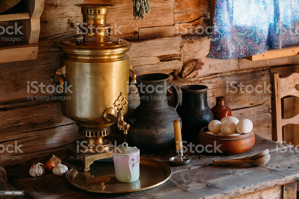Interior of kitchen room in russian traditional wooden house in stock photo