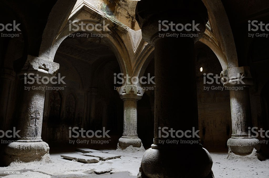 Interior of medieval christian temple Geghard with columns, Armenia, unesco stock photo