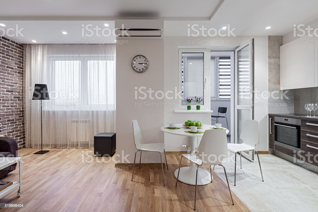 Interior of modern apartment in scandinavian style with kitchen stock photo