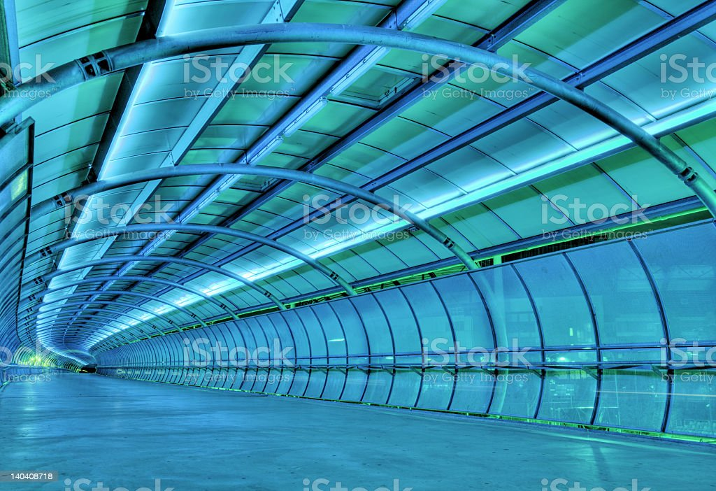 Interior of modern blue tunnel lit up stock photo