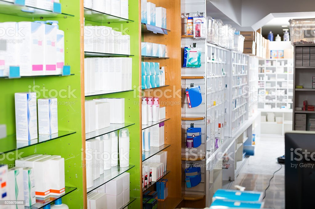 Interior of modern drugstore with goods in cabinets and shelves stock photo