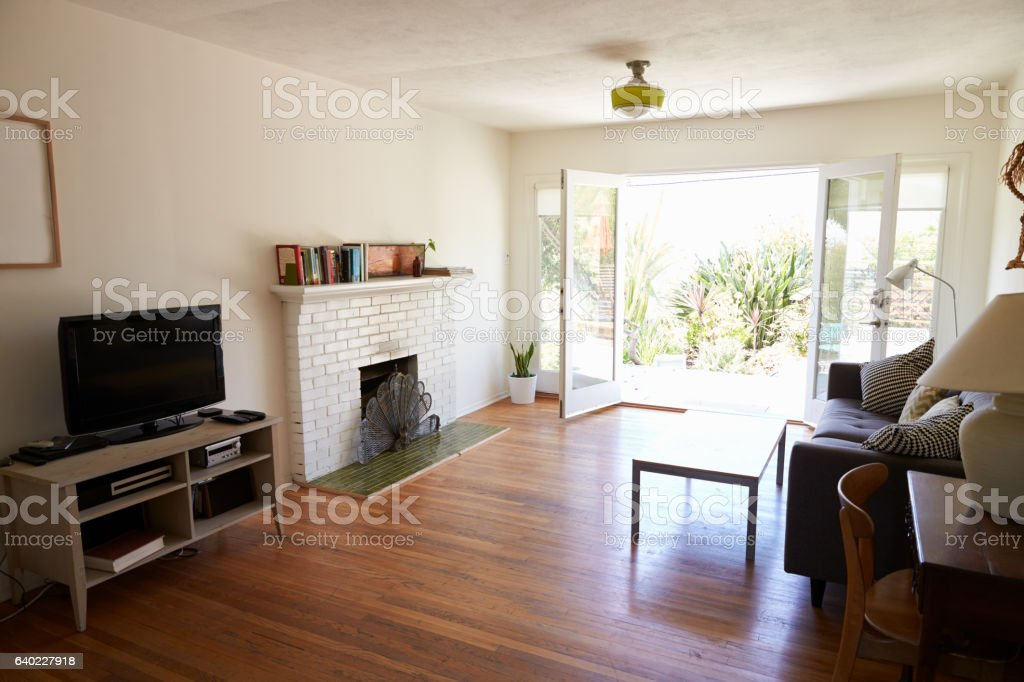 Interior Of Modern Lounge With Open French Windows To Garden stock photo