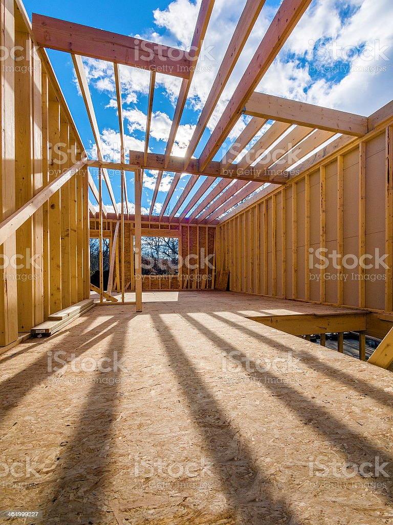 Interior of new house being framed during construction stock photo