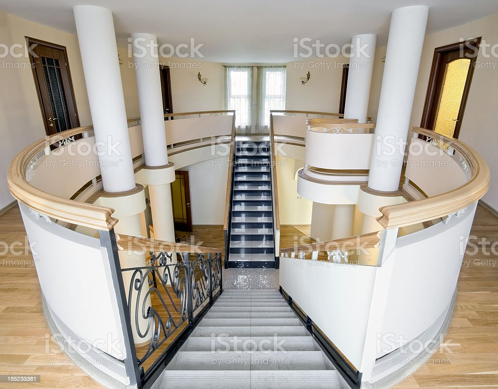 Interior of new mansion with staircase and balcony indoors royalty-free stock photo