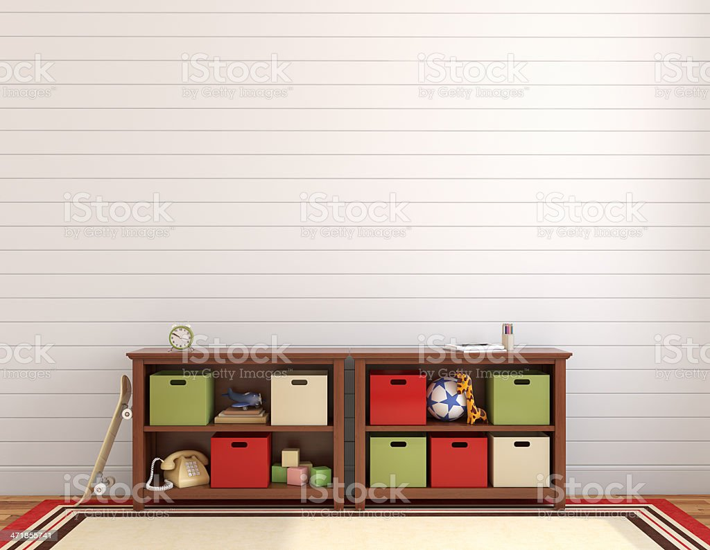 Interior of playroom with shelf bins a rug and paneled wall royalty-free stock photo