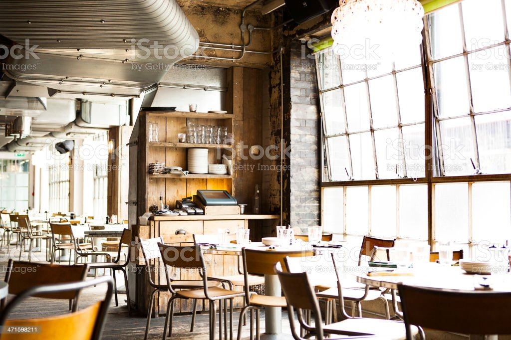 Interior of restaurant with table settings stock photo