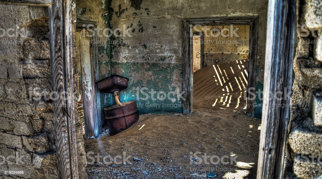 Interior of ruined house in ghost-town Kolmanskop Namibia stock photo