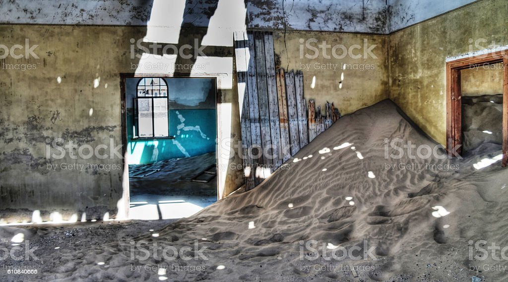 Interior of ruined house in ghost-town Kolmanskop stock photo