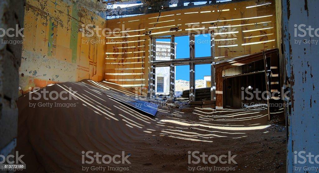 Interior of ruined house in ghost-town Kolmanskop stock photo