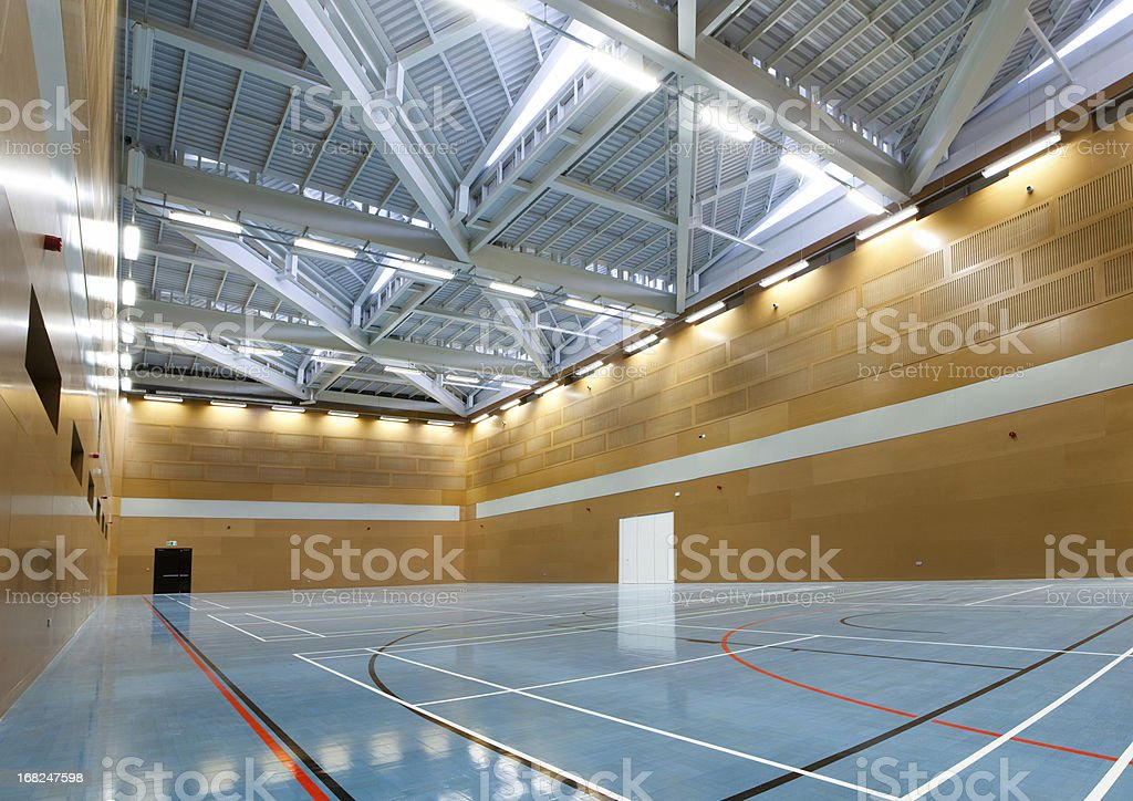 Interior of school gym with blue flooring royalty-free stock photo