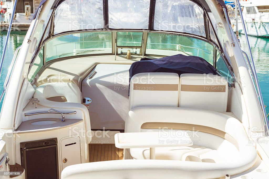 Interior of small yacht in white eco-leather in Marina stock photo