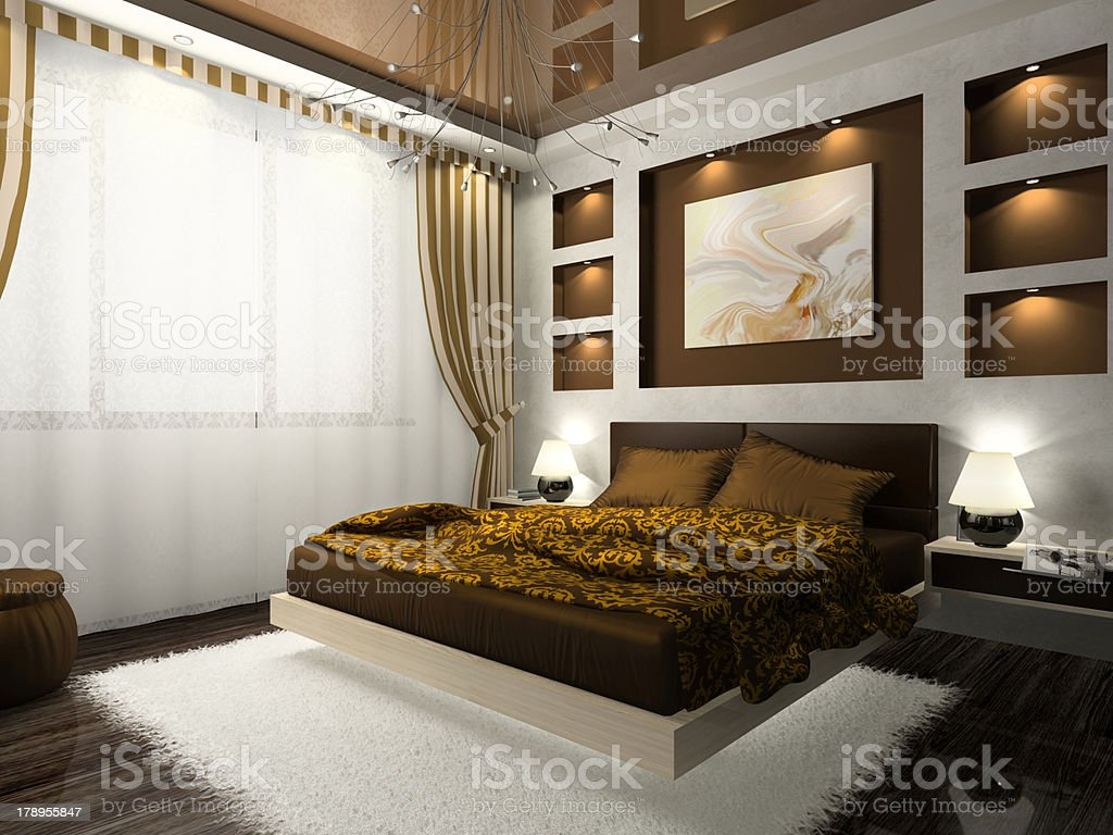 Interior of the comfortable bedroom in brown color royalty-free stock photo