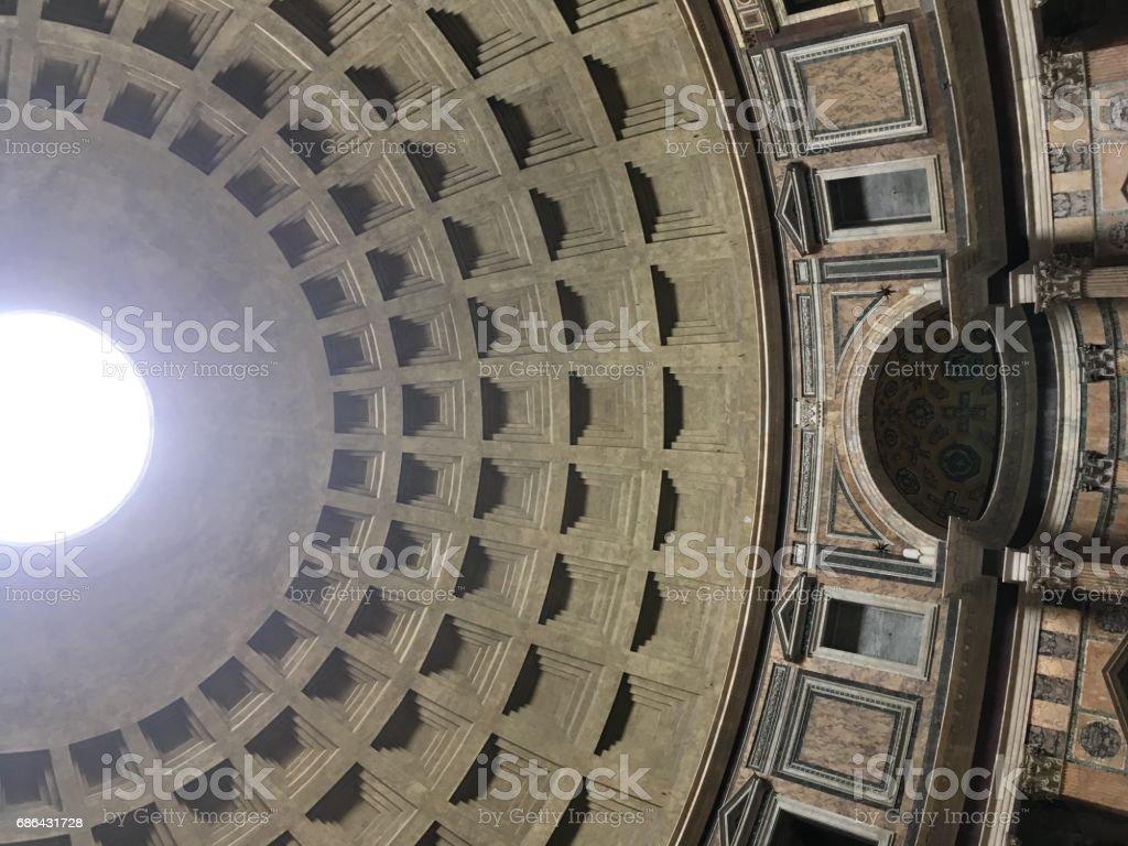 Interior of the Pantheon in Rome, Italy.  Looking up at the skylight, the only source of light to the structure.  Coffered ceiling, low angle. stock photo