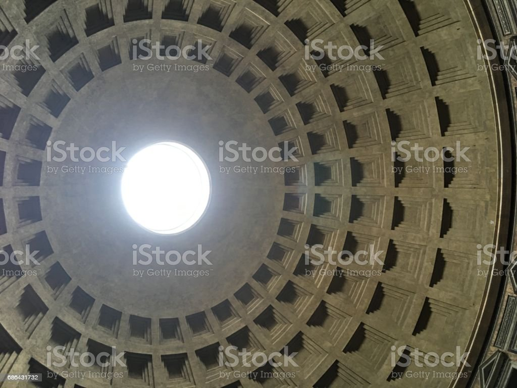 Interior of the Pantheon in Rome, Italy.  Looking up at the skylight, the only source of light to the structure.  Coffered ceiling. stock photo
