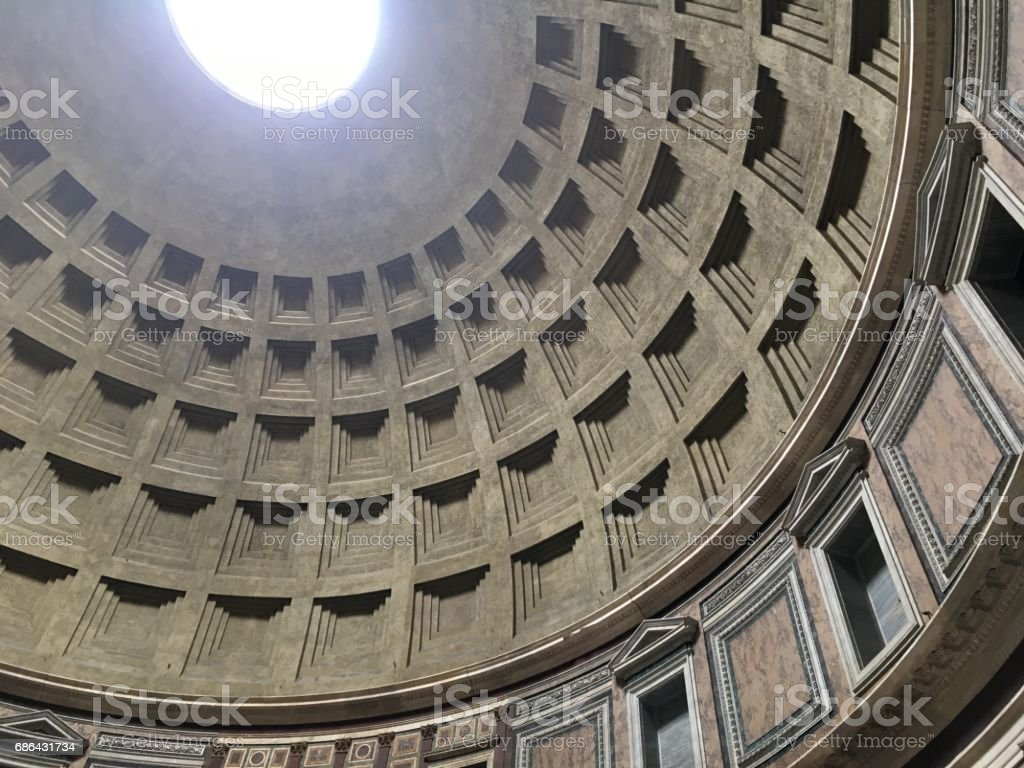 Interior of the Pantheon in Rome, Italy.  Looking up at the skylight, the only source of light to the structure. Look up into the skylight. stock photo