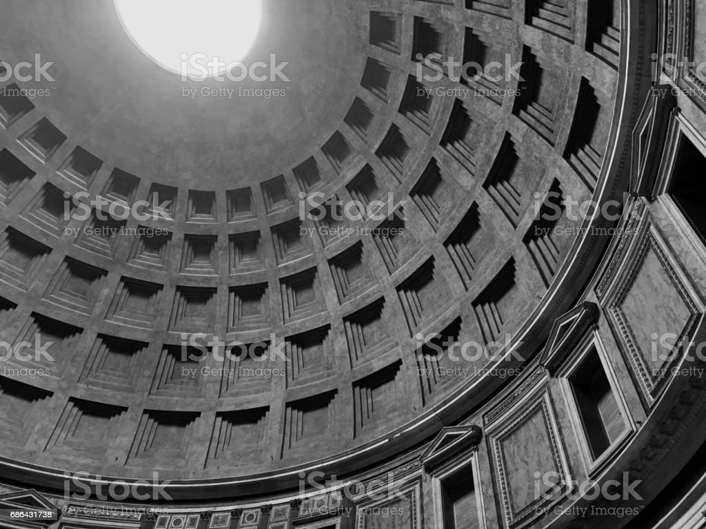 Interior of the Pantheon in Rome, Italy.  Looking up at the skylight, the only source of light to the structure. Looking up.  Black and white. stock photo