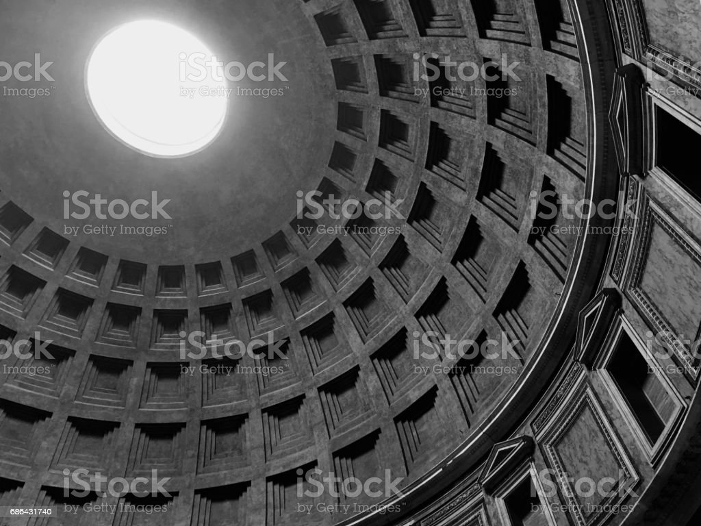 Interior of the Pantheon in Rome, Italy.  Looking up at the skylight, the only source of light to the structure.  Black and white image. stock photo