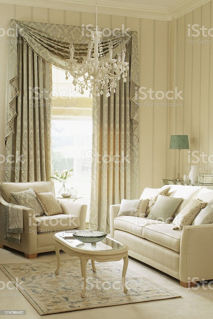 Interior of three seater sofa and chair in living room stock photo