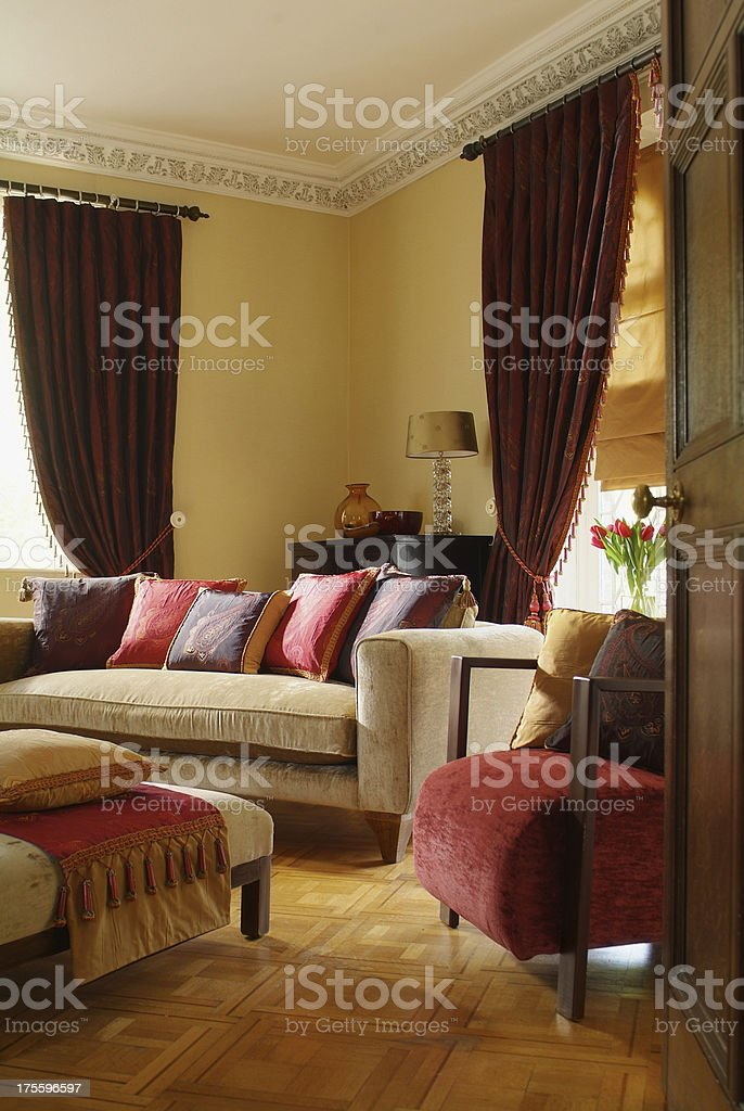 Interior of three seater sofa and chair in living room royalty-free stock photo