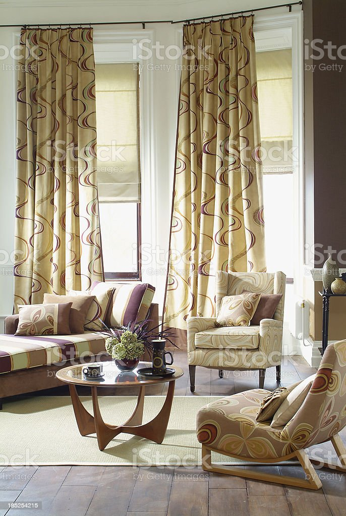 Interior of three seater sofa and chairs in living room stock photo