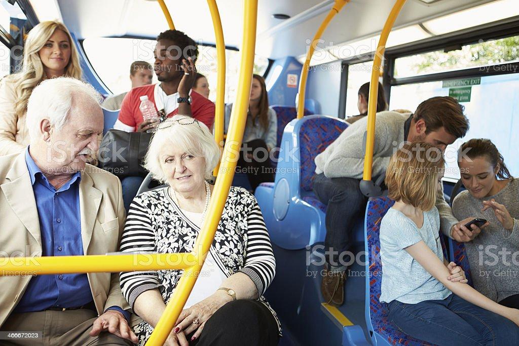Interior of tourist bus cramped with passengers stock photo