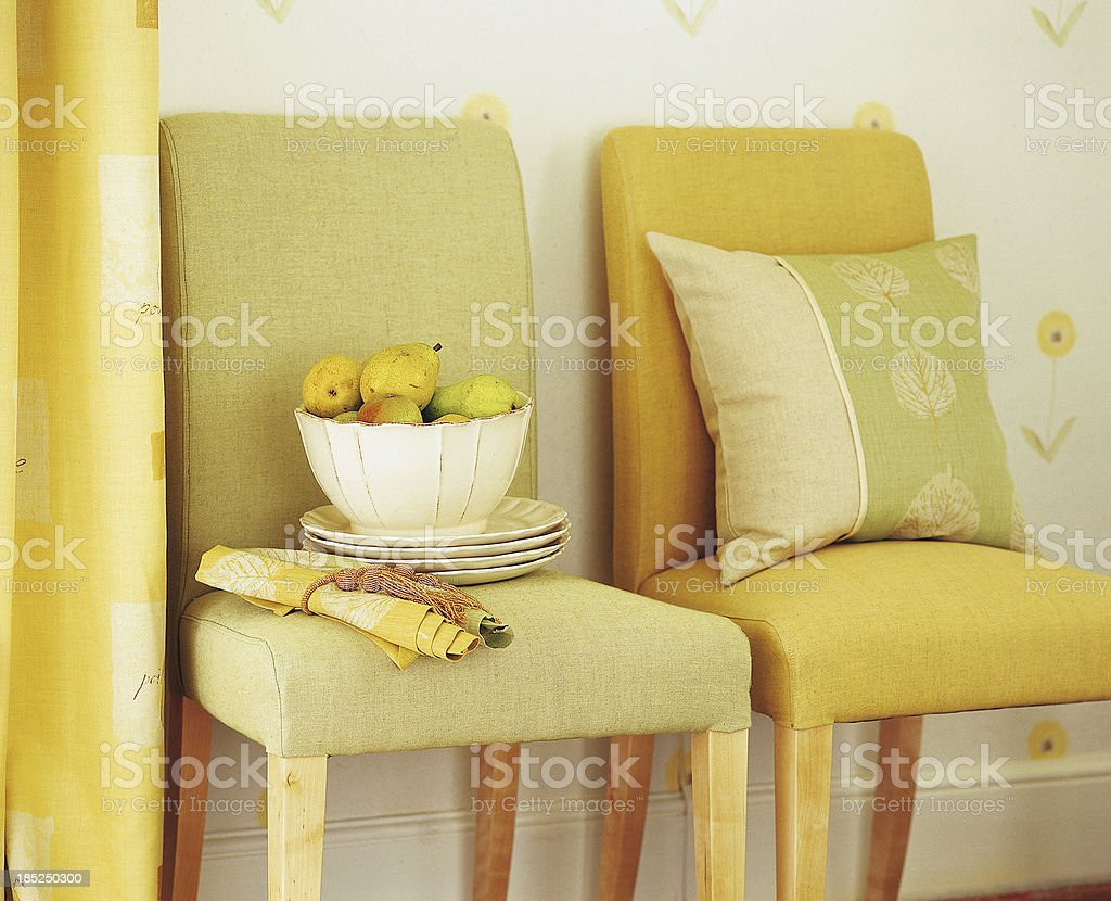 Interior of two modern chairs with cushions and decorations royalty-free stock photo