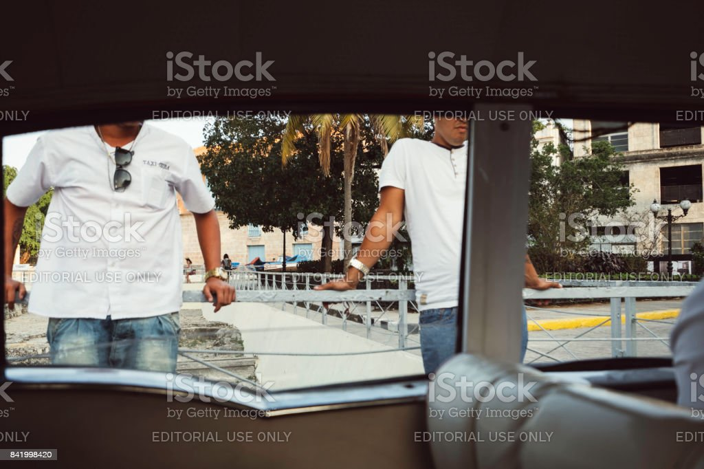 Interior of vehicle partial view of two men in white t-shirts stock photo