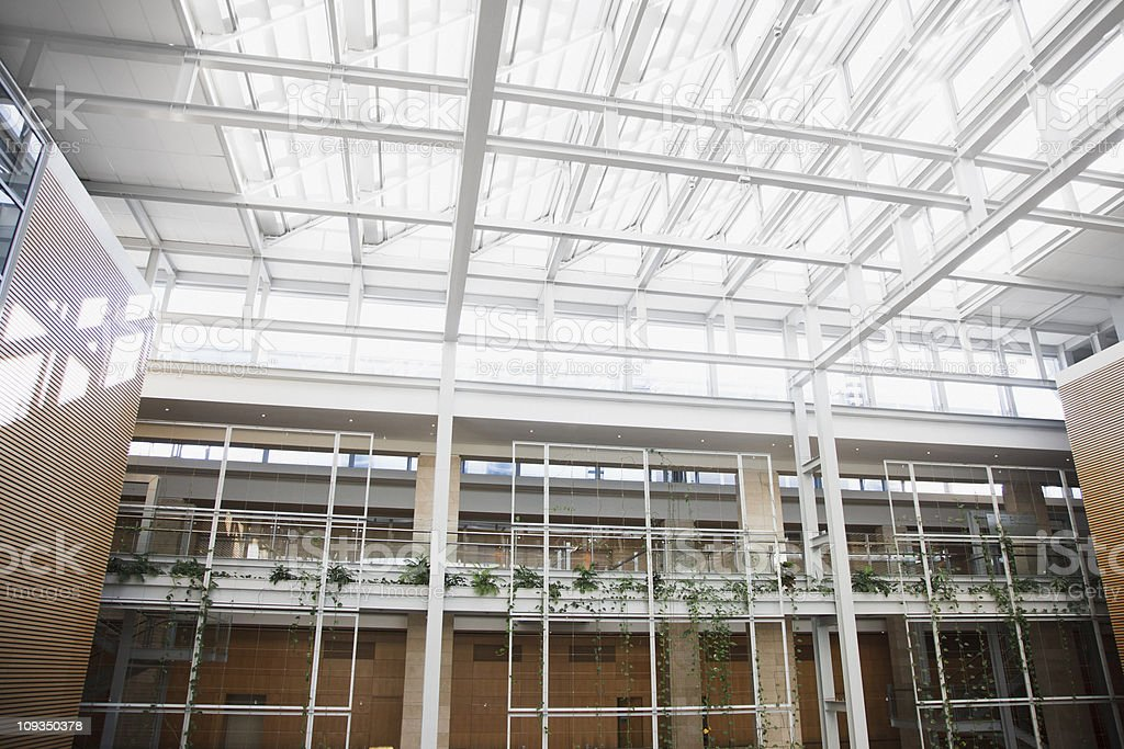 Interior of walkways and skylight in modern office building stock photo