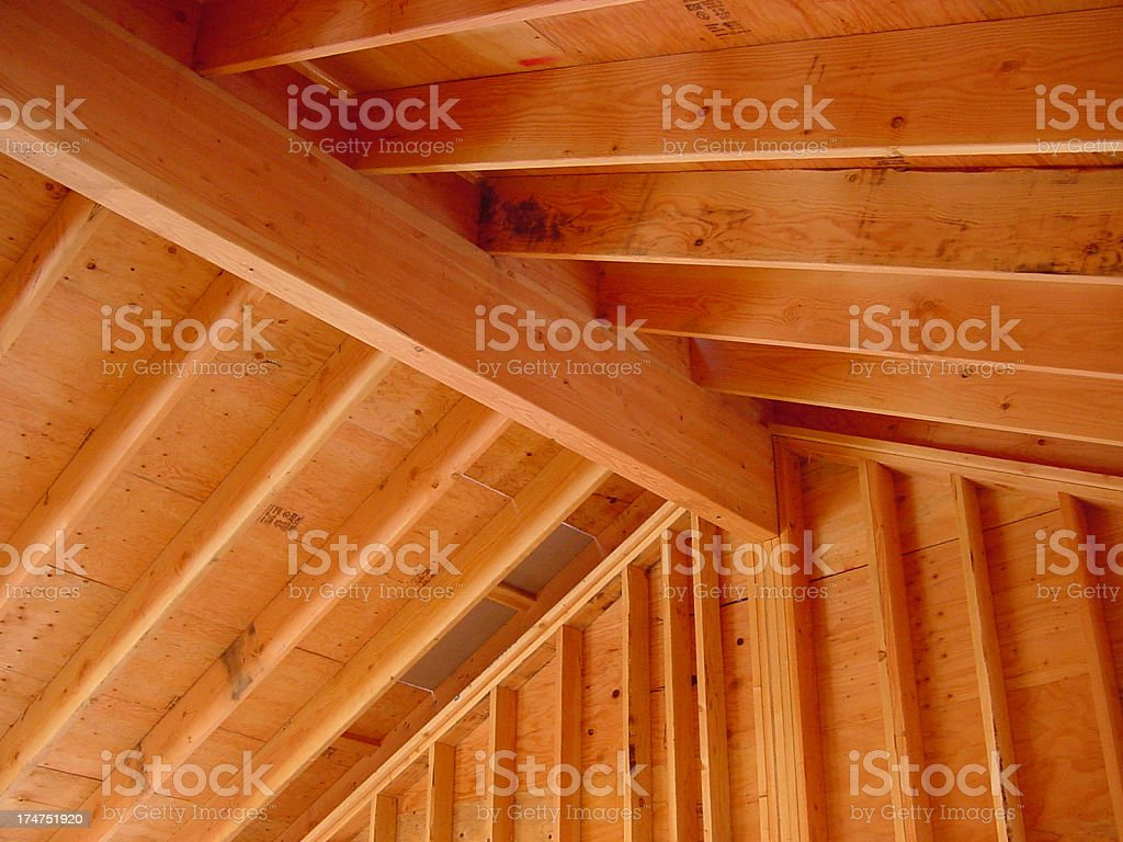 Interior ridge beam and rafter construction stock photo