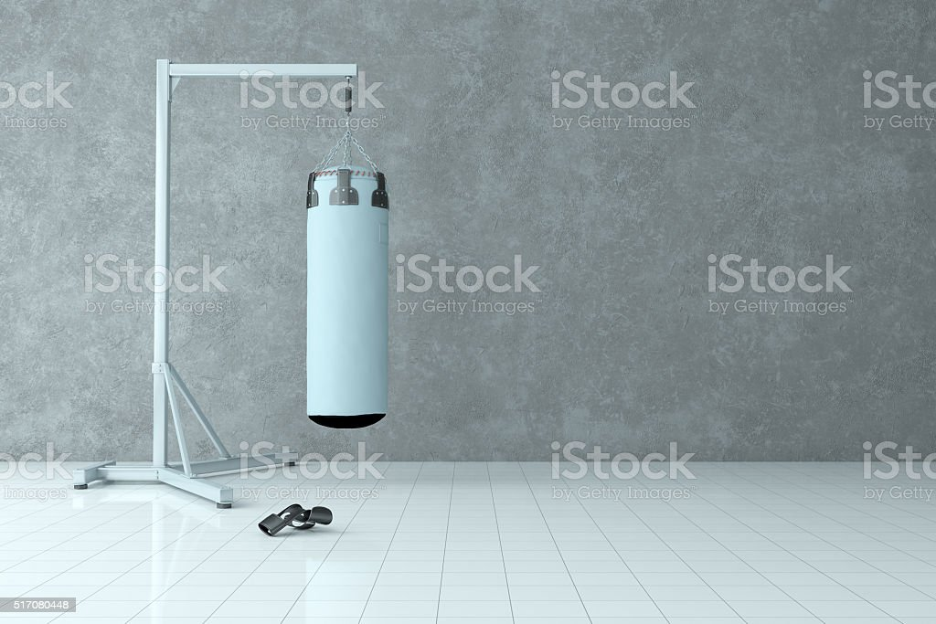 Interior Scene With Punch Bag and Textured Wall Background stock photo