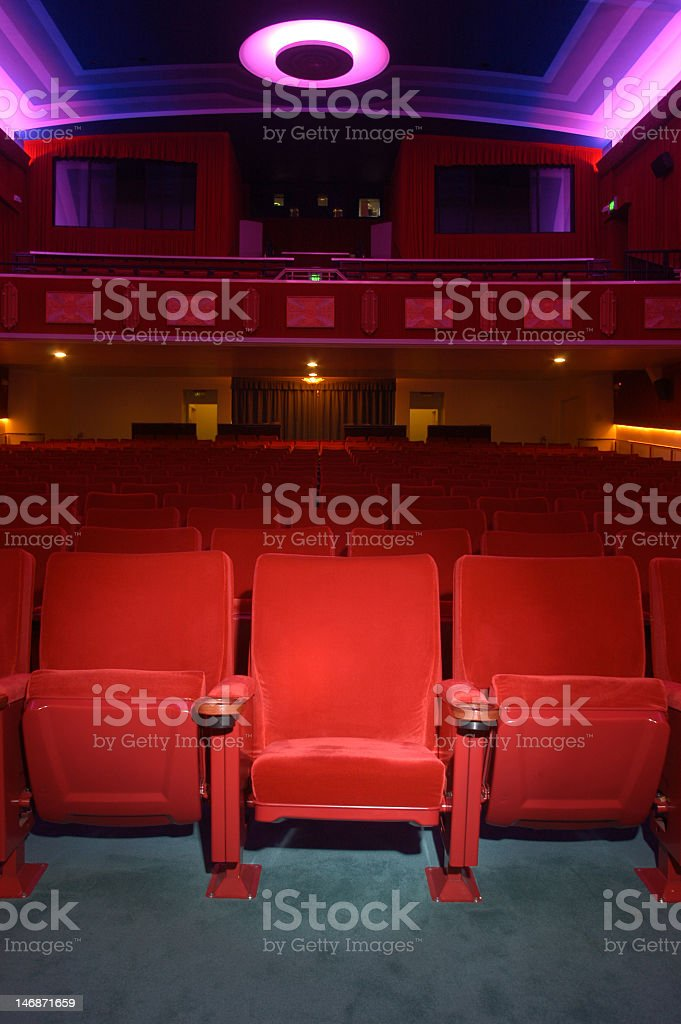 Interior shot of a movie theatre facing away from the screen royalty-free stock photo