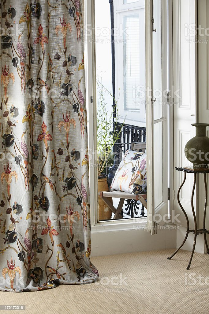 Interior shot of curtain in large open French window stock photo