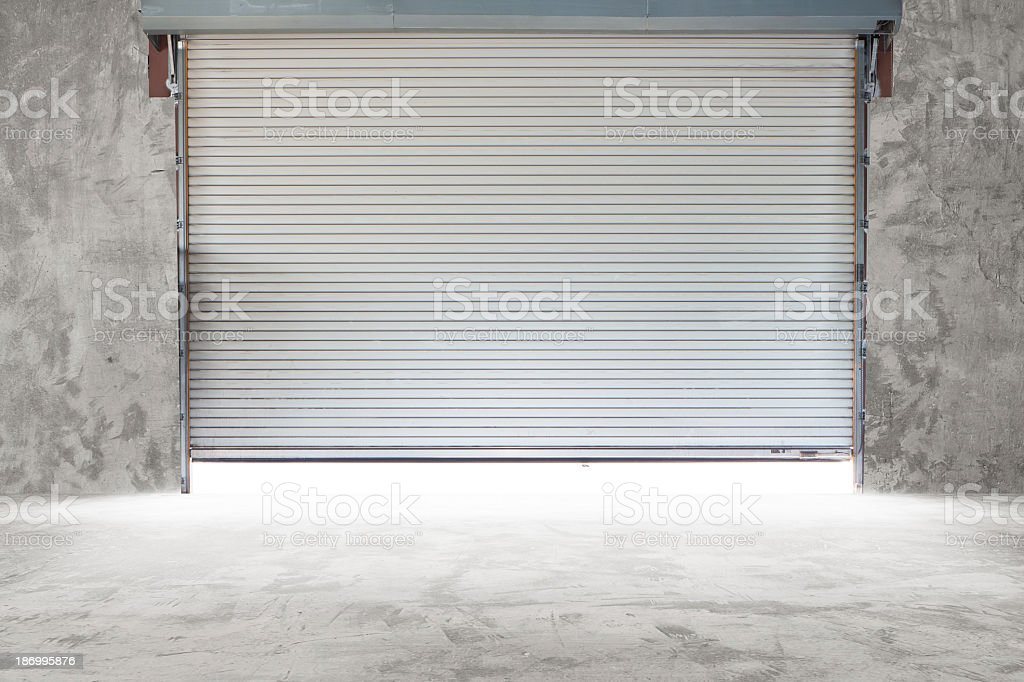 Interior view of a building with a roller shutter door stock photo