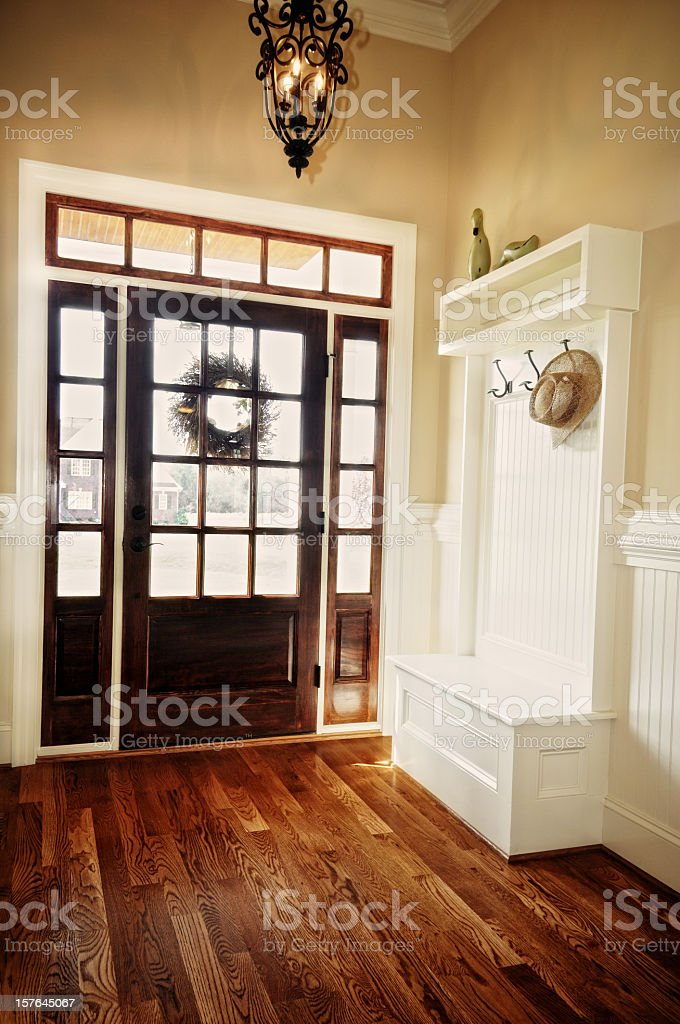 Interior view of a foyer with a coat hook shelf  stock photo