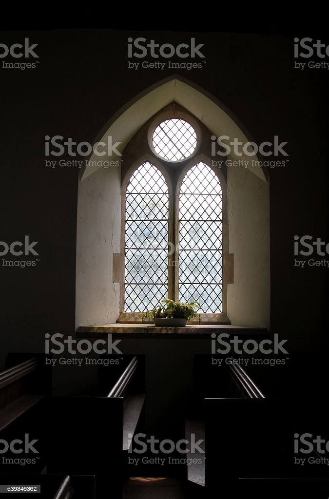 interior view of church window and pews stock photo