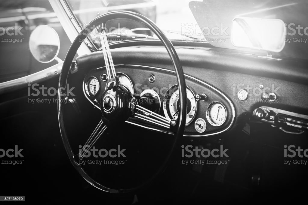 Interior view of classic vintage car. Instagram toning. Beautiful retro car poster, postcard. stock photo